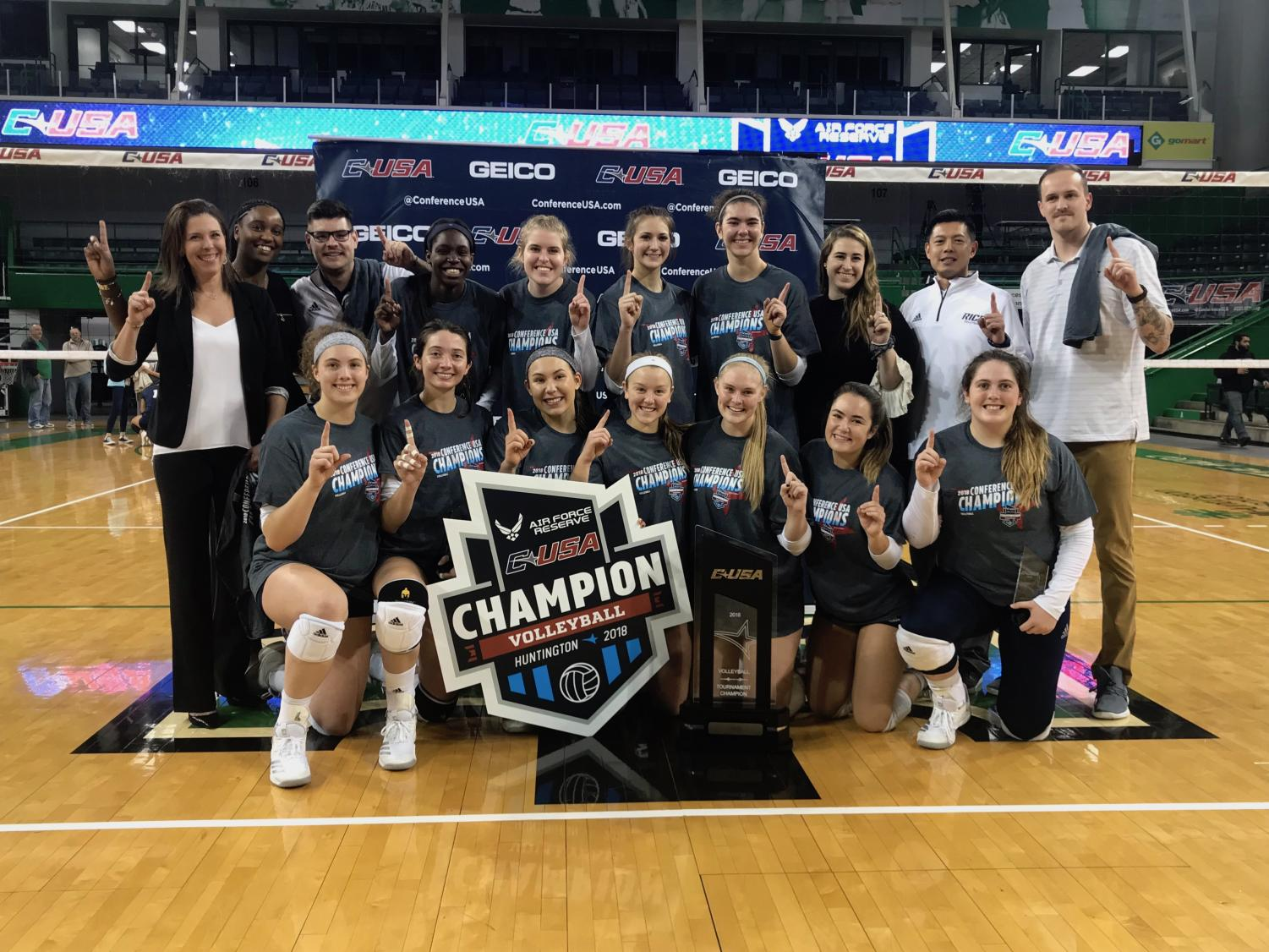 The Rice volleyball team poses with the Conference-USA Championship trophy after defeating FIU 3-1.