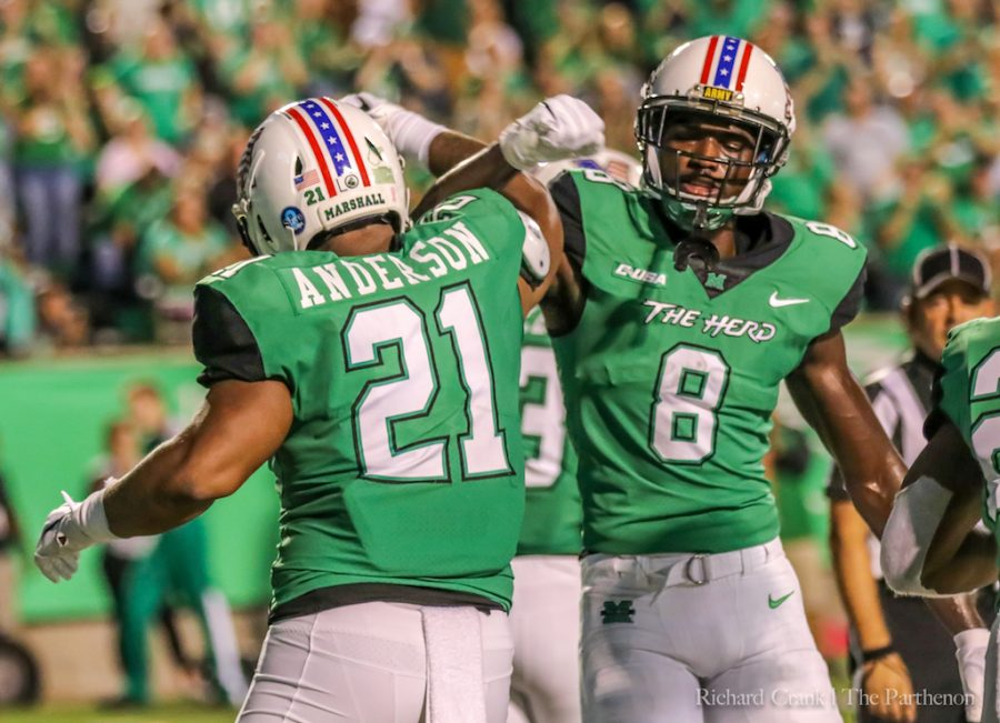 Redshirt+senior+running+back+Anthony+Anderson+and+Senior+wide+receiver+Tyre+Brady+during+Marshall%27s+game+against+Middle+Tennessee.