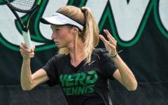 Victoria Walter hits a forehand shot during one of Marshall's fall practices.