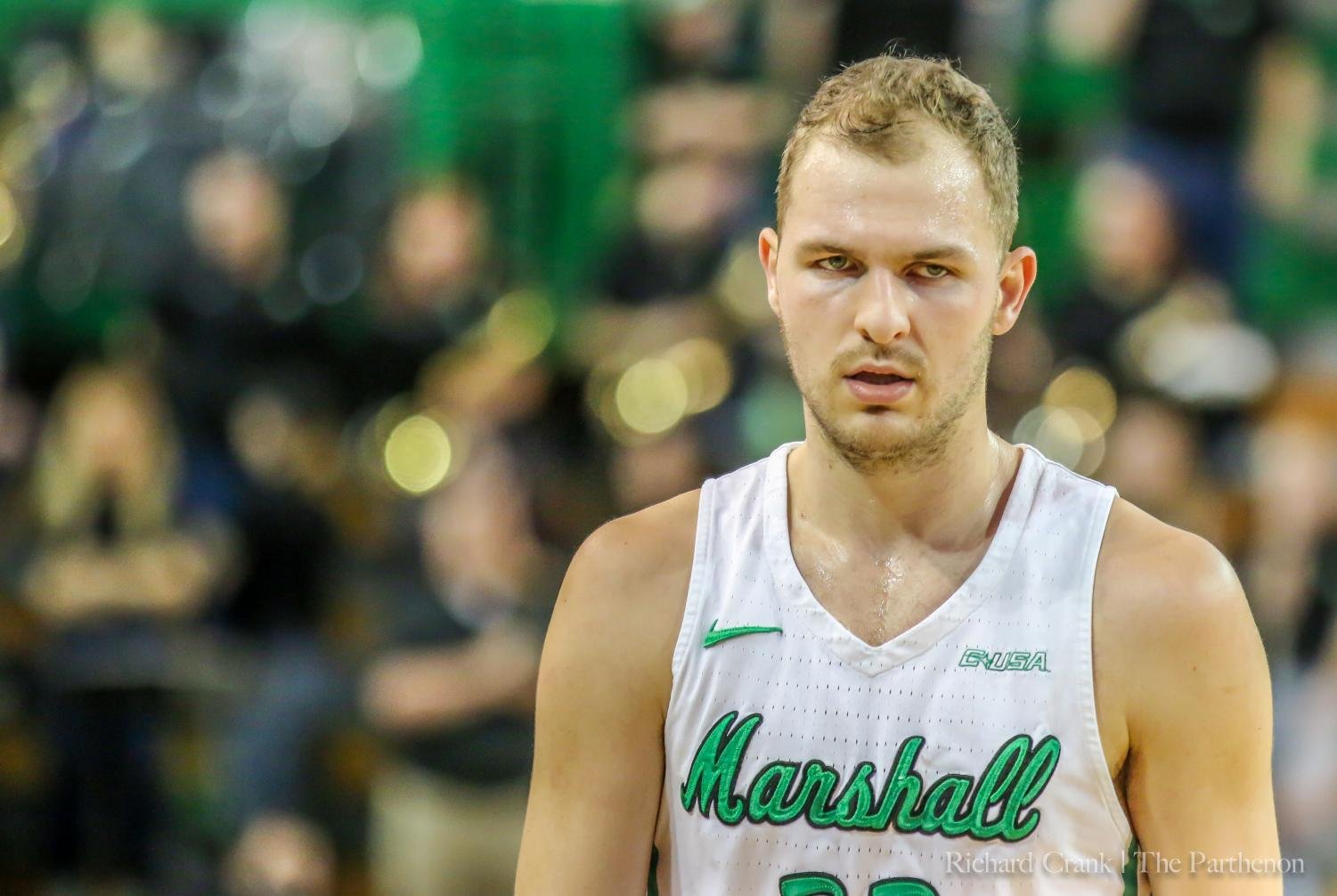 Marshall guard Jon Elmore (33) looks up the court during a stoppage of play.