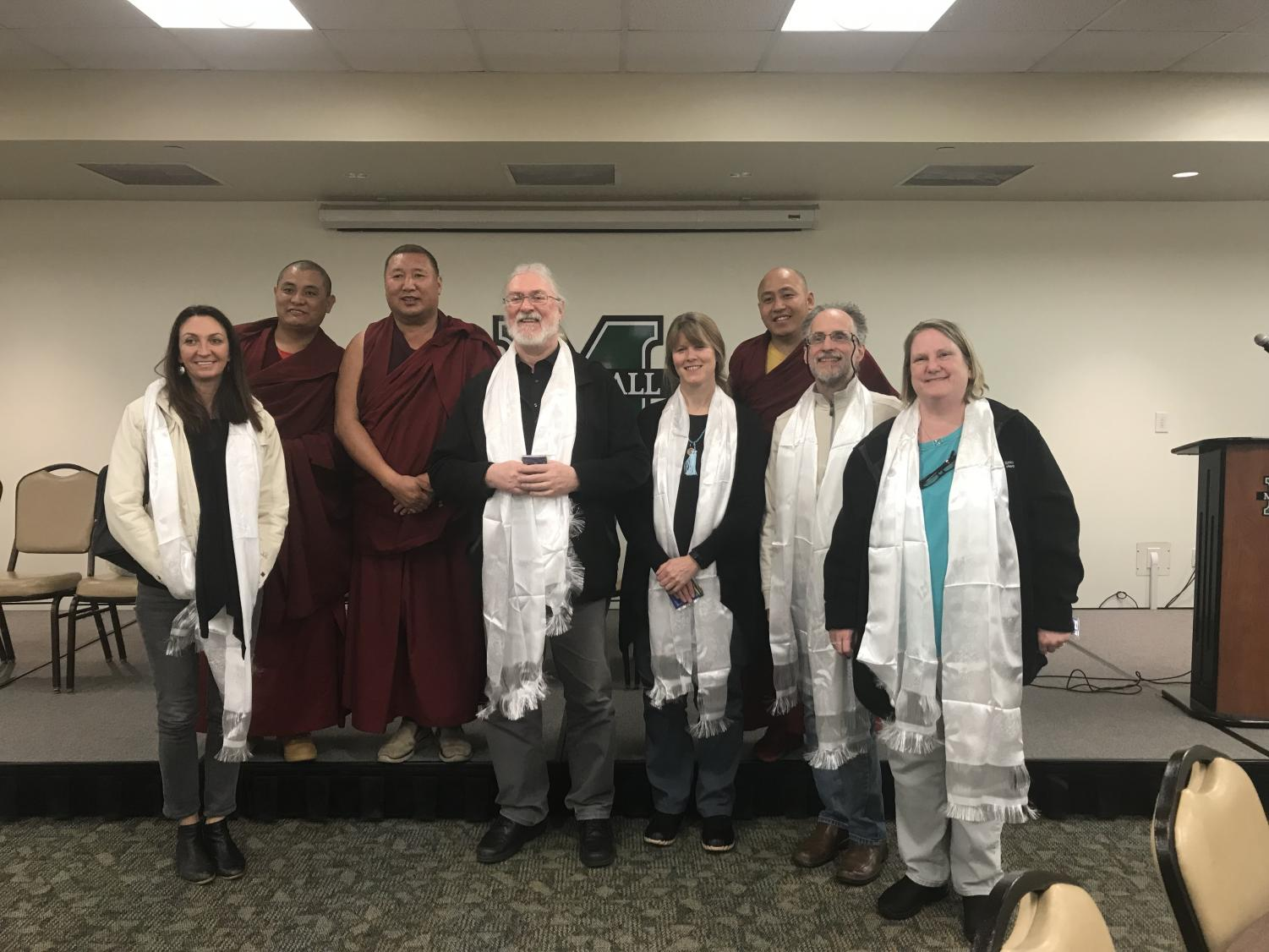 Monks from the Tashi Kyil Monastery in Dehradun, India, pose for a photo with Marshall University faculty.