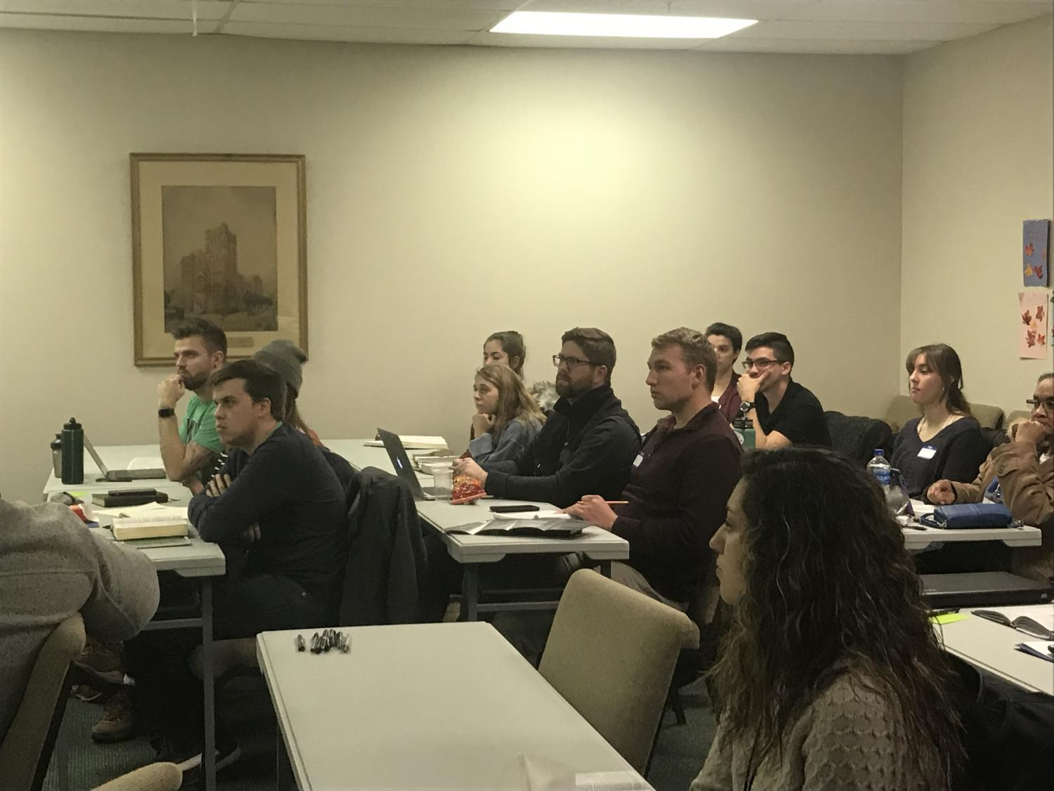 Participants of the Perspectives course listen to guest speaker, Matthew Chittum, during Thursday's course.