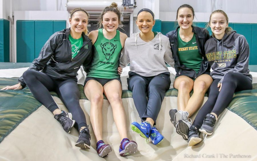 Marshall pole vaulters Lauren Zaglifa and Macie Major pose for a photo with the Wright State pole vaulters at the Marshall Women's Classic.
