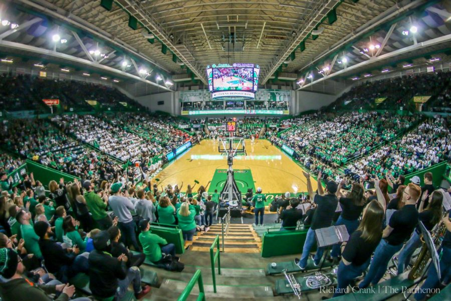 7%2C687+fans%2C+mostly+clad+in+green+and+white%2C+look+on+during+the+first+half+of+Marshall%27s+70-69+win+over+WKU.