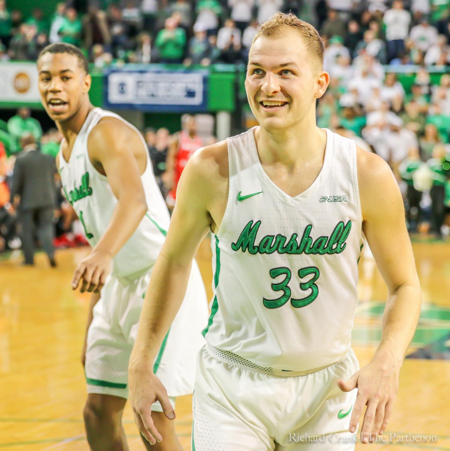 Marshall's Taevion Kinsey (1) and Jon Elmore (33) are all smiles during the Herd's 70-69 win over WKU.