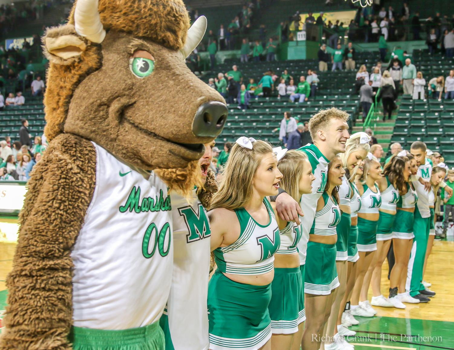 Marshall University cheerleaders and Marco sing the university's alma mater following a home basketball game against WKU on Jan. 12, 2019.