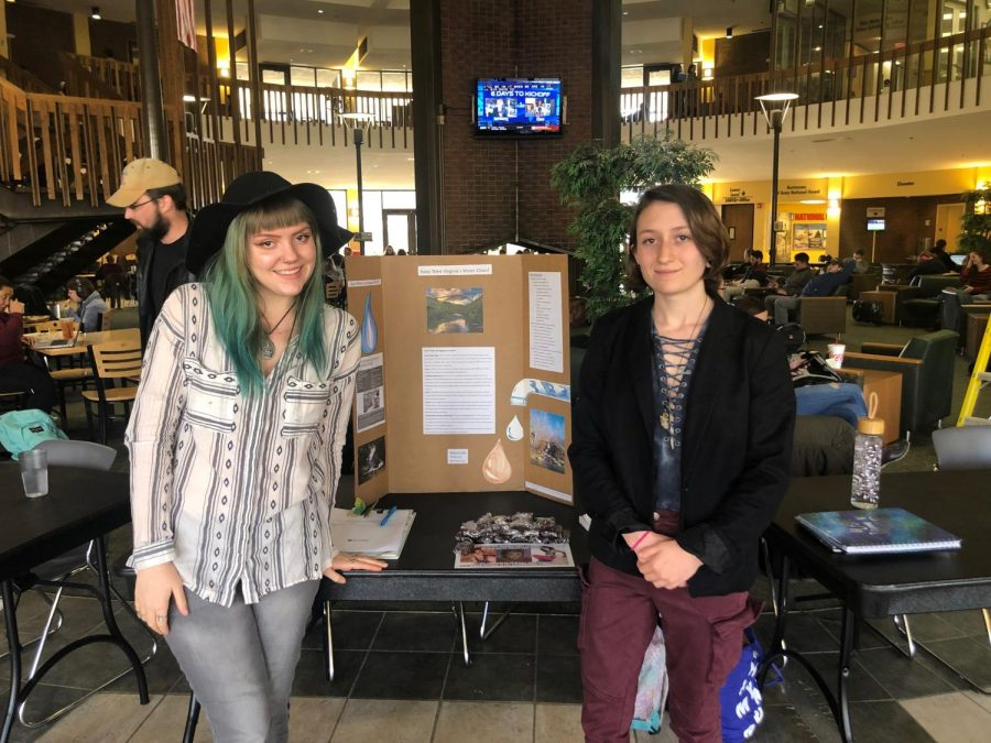 Baleigh+Epperly+%28left%29+and+Abi+Gail+Taylor+%28right%29+tabling+in+the+Memorial+Student+Center+to+raise+awareness+about+keeping+West+Virginia+water+clean.+