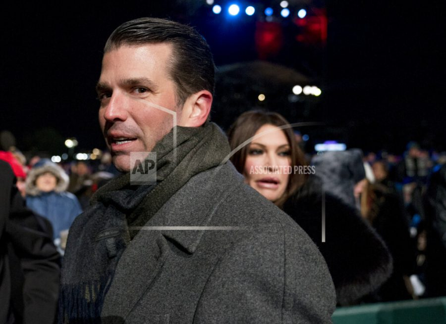 FILE - In this Nov. 28, 2018, file photo, Donald Trump Jr., center, and Kimberly Guilfoyle, right, depart following the National Christmas Tree lighting ceremony at the Ellipse near the White House in Washington. Senate investigators have evidence revealing the identities behind two mysterious phone calls that Donald Trump Jr. had with blocked numbers during the 2016 presidential campaign, just days before he met with a Russian lawyer promising dirt on Democratic candidate Hillary Clinton. According to phone records provided to Congress, Trump Jr. spoke to Howard Lorber, a New York real estate executive, and Brian France, the former chairman of NASCAR, two people familiar with the records told The Associated Press. (AP Photo/Andrew Harnik, File)