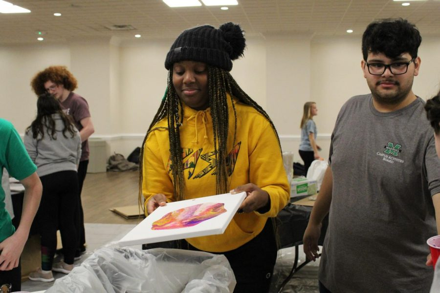 Marshall students participate in the DIY dirty pour painting event at the Memorial Student Center.