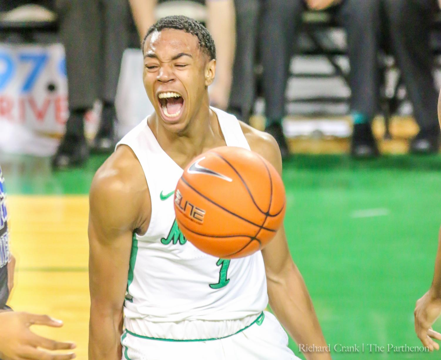Marshall guard Taevion Kinsey (1) celebrates a dunk during the Thundering Herd's game against Middle Tennessee at the Cam Henderson Center.