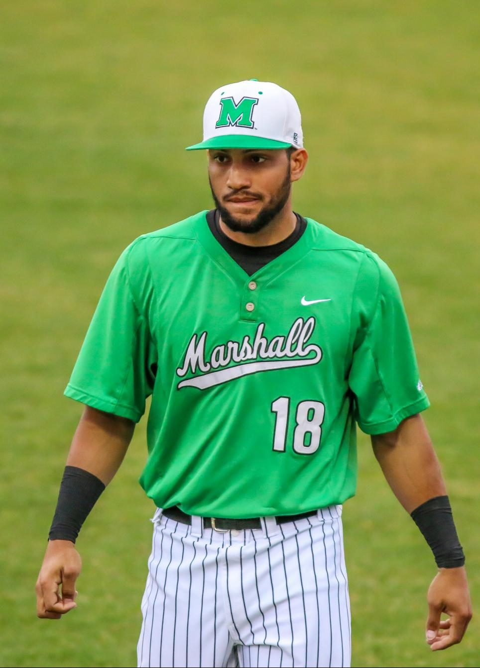Marshall outfielder Erik Rodriguez (18) warms up before the Thundering Herd's 2018 contest against West Virginia at Appalachian Power Park.