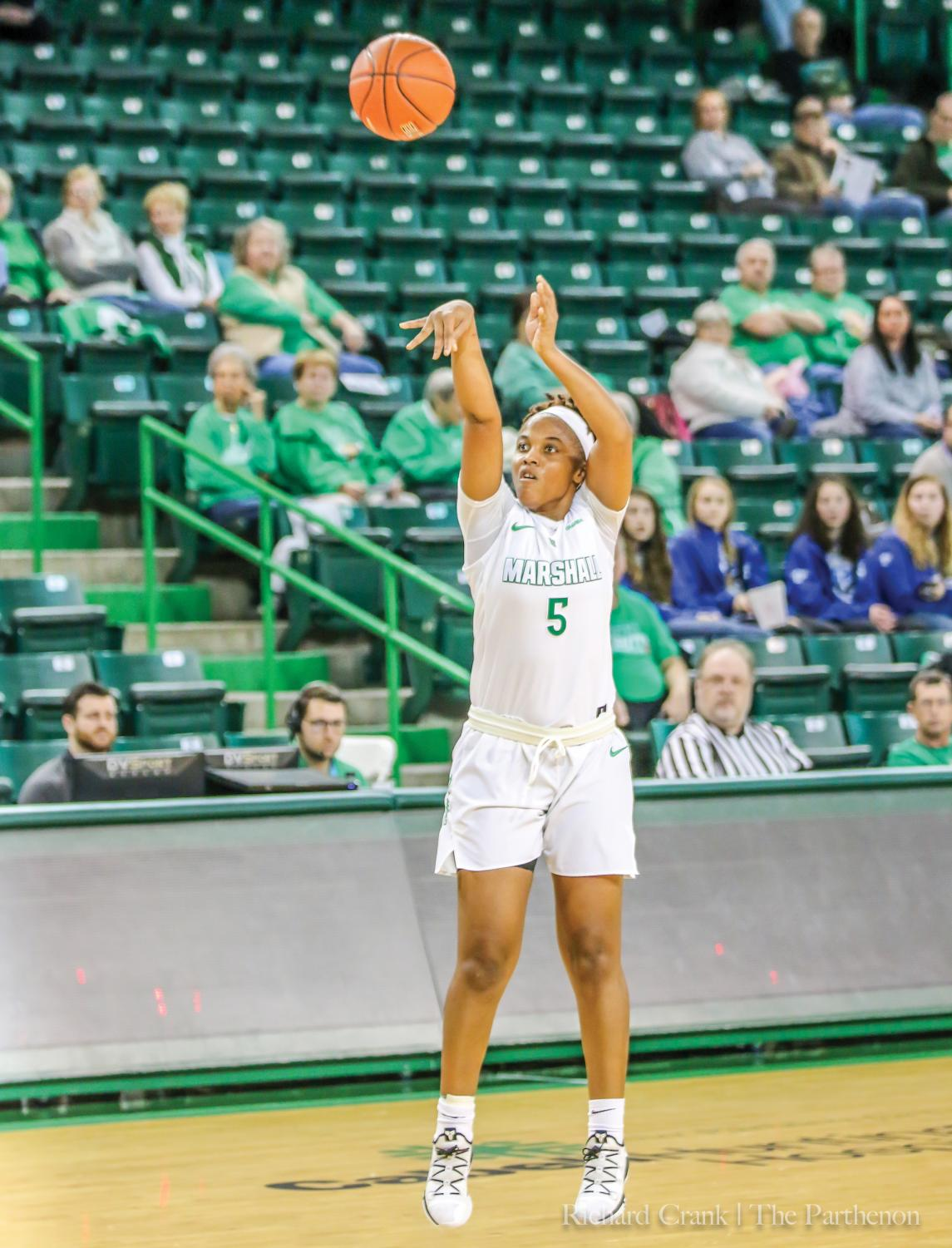 Marshall guard Princess Clemons (5) shoots a 3-pointer during the Thundering Herd's 90-88 triple-overtime win over Louisiana Tech. The Herd currently is in a tie for third place in Conference USA.