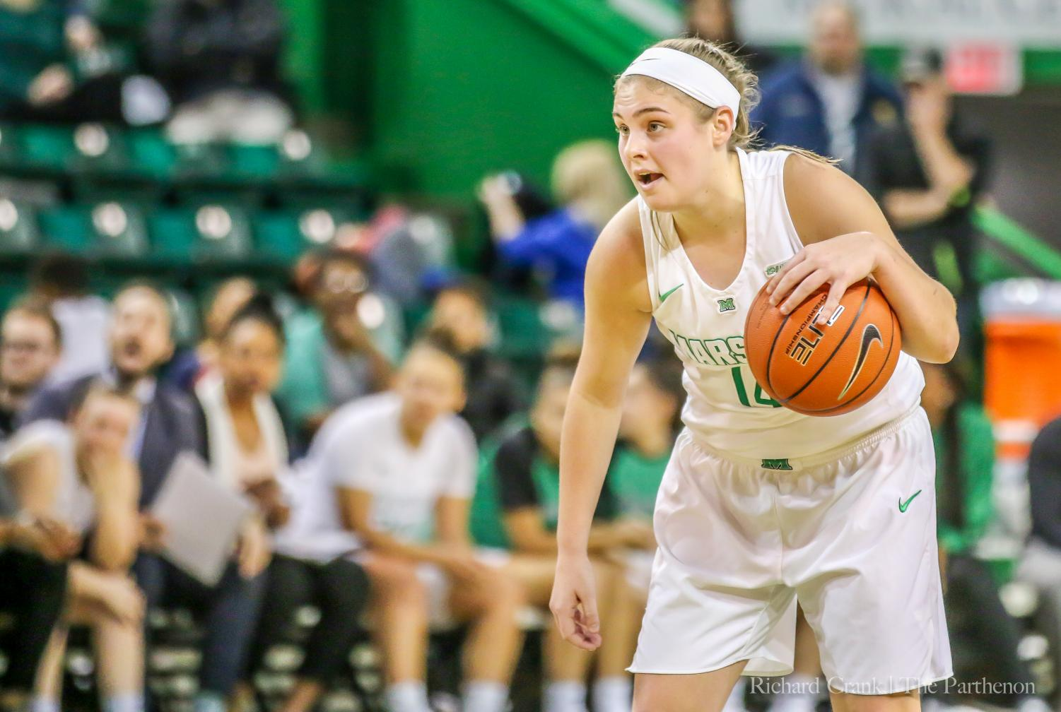 Marshall guard Shayna Gore (14) prepares to run a play during a Conference USA game against Louisiana Tech at the Cam Henderson Center.