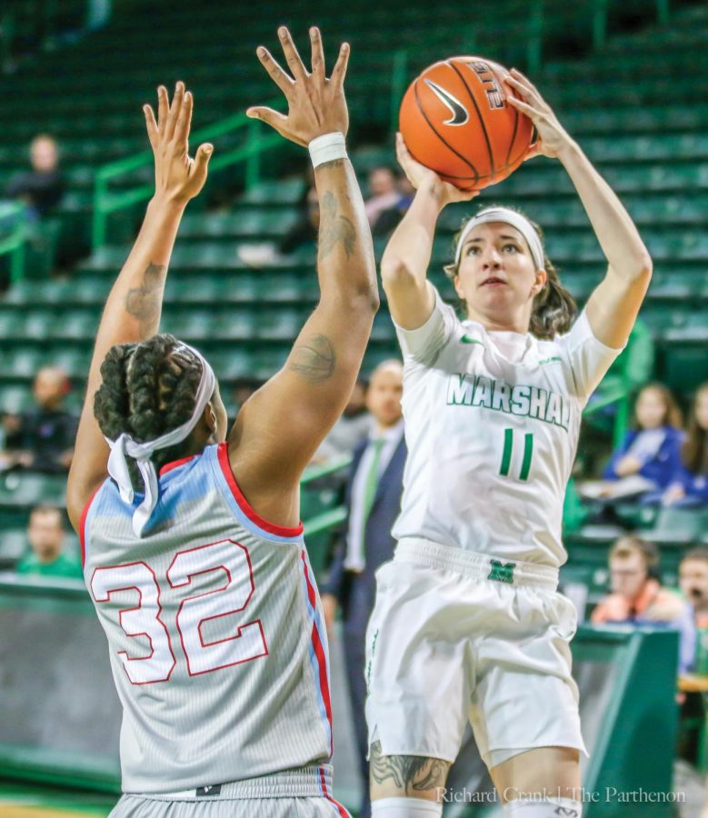 Marshall+guard+Taylor+Porter+%2811%29+attempts+a+jump+shot+over+the+outstretched+arms+of+Louisiana+Tech+forward+Zhanae+Whitney+during+the+Herd%E2%80%99s+90-88+triple+overtime+win+on+Jan.+24%2C+2019.