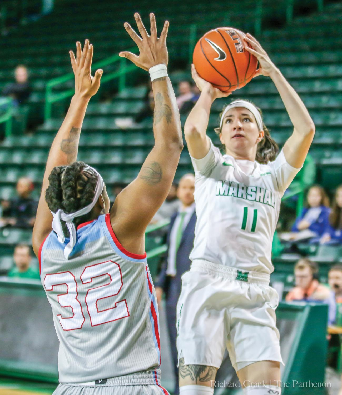 Marshall guard Taylor Porter (11) attempts a jump shot over the outstretched arms of Louisiana Tech forward Zhanae Whitney during the Herd's 90-88 triple overtime win on Jan. 24, 2019.