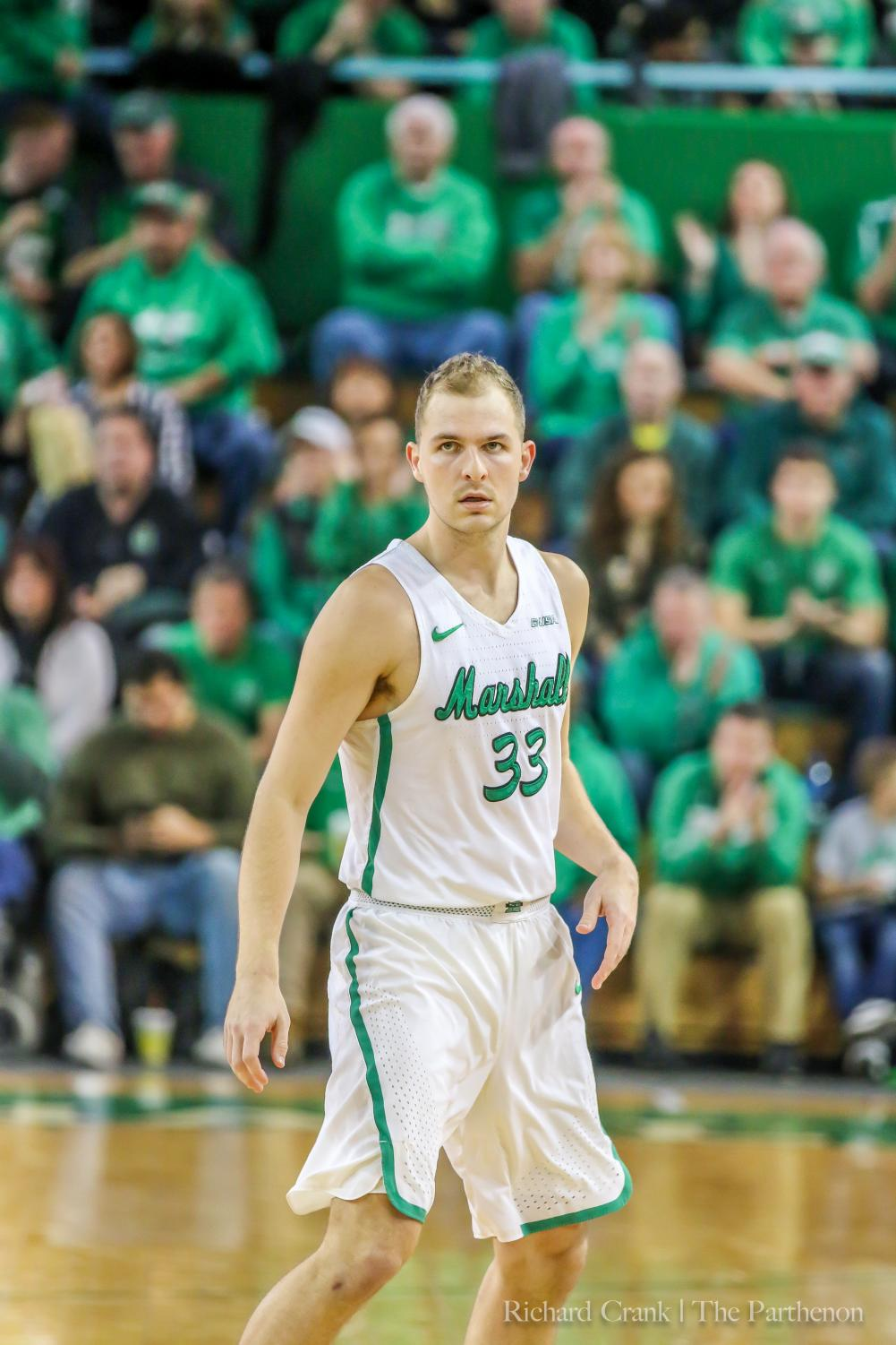 Marshall guard Jon Elmore (33) looks for a play call during a stoppage in the Thundering Herd's game against WKU at the Cam Henderson Center.