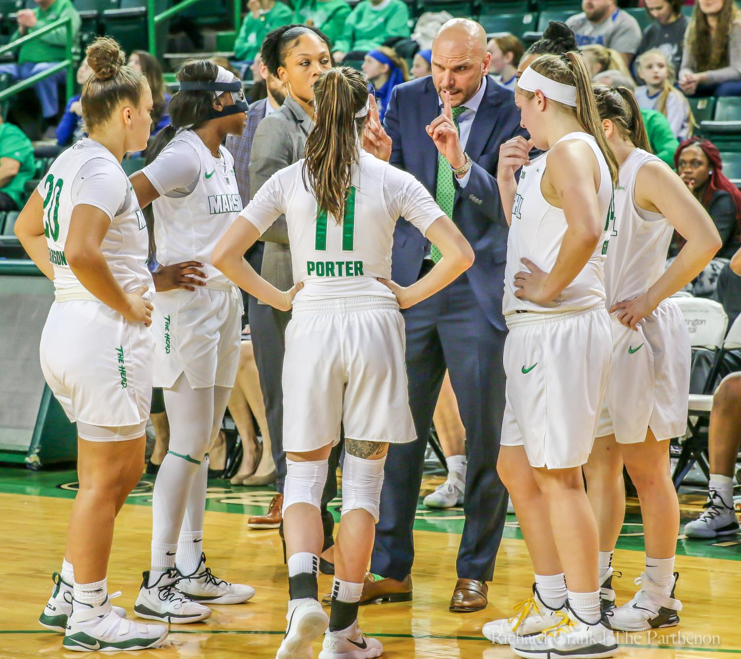 Tony Kemper coaches his team during a timeout in Marshall's C-USA game against LA Tech.