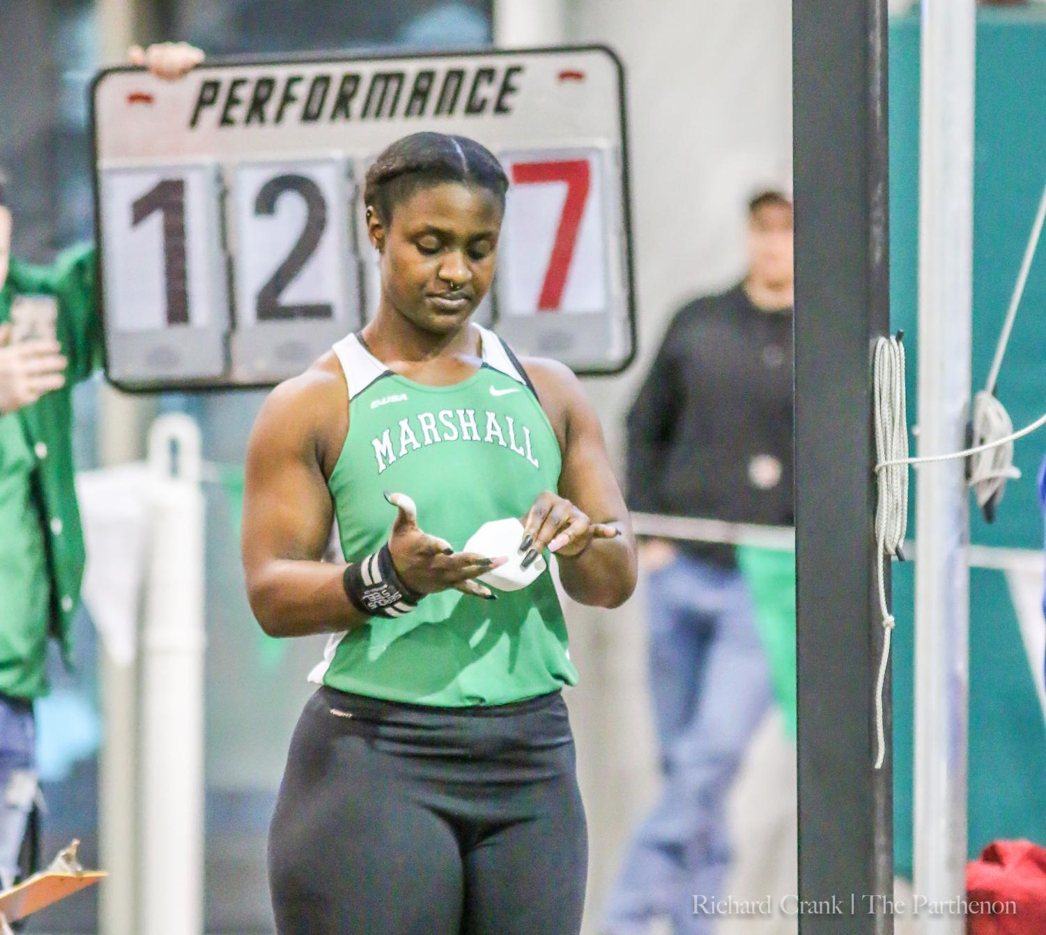 Marshall senior thrower Hasana Clark prepares to participate in the weight throw at the Qdoba Marshall Invitational. Clark set a new personal record in the event with a throw of 20.48 meters.