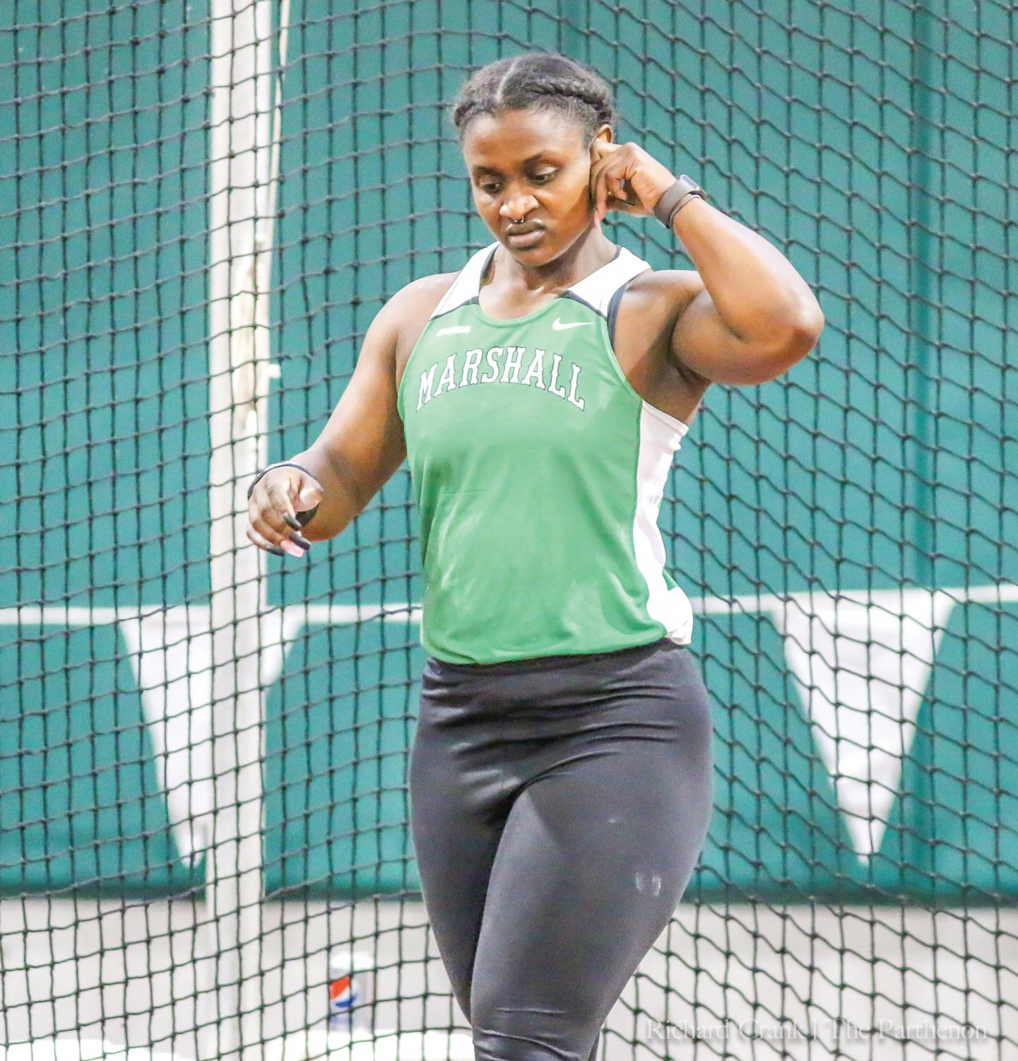 Hasana Clark prepares to participate in the weight throw at the Qdoba Marshall Invitational.
