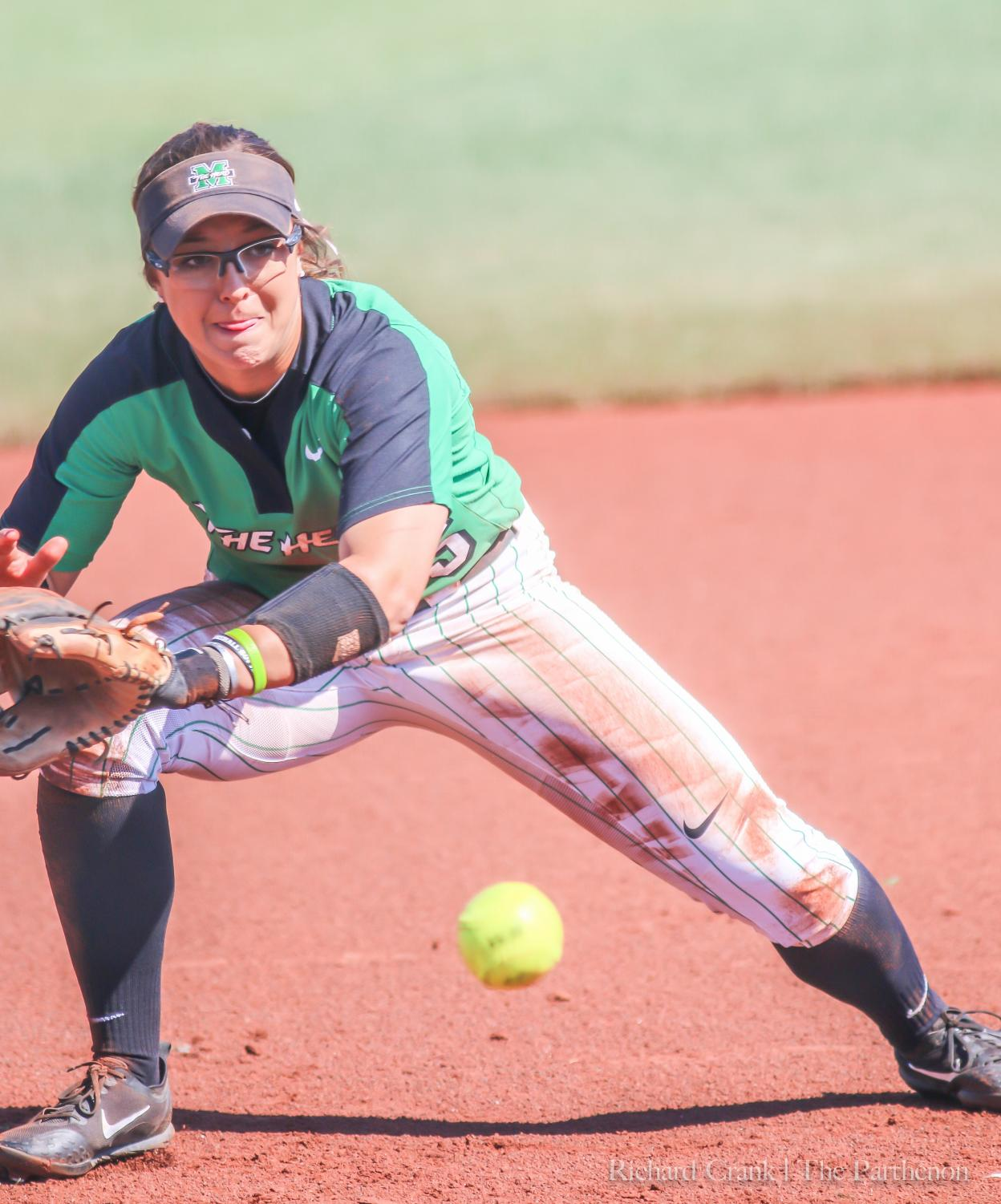 Infielder Blakely Burch (55) fields a ground ball during Marshall's 2018 game against Morehead State at Dot Hicks Field.