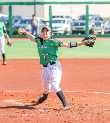 Marshall pitcher Kailee Williamson (77) prepares to throw a pitch during a 2018 game against Morehead State at Dot Hicks Field.