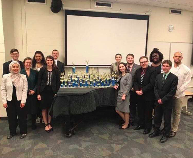 Members+of+last+year%27s+Thundering+Word+Speech+and+Debate+Team+pose+with+trophies+at+last+year%27s+state+tournament.