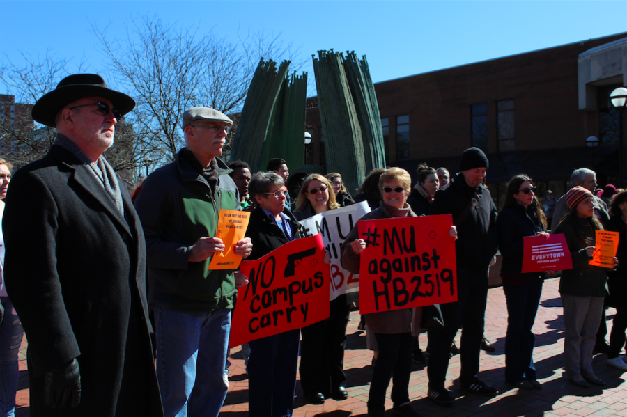 Locals gather to protest proposed campus-carry bill, Monday at Marshall University's Memorial Fountain.