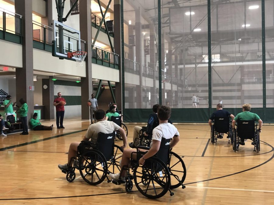 Members+of+Marshall+University+Greek+Life+participate+in+Wheelchair+Basketball%2C+an+awareness+event+for+Developmental+Disabilities+Awareness+Month%2C+Friday+in+the+Marshall+Recreation+Center.