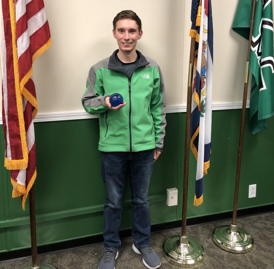 Student Body President Hunter Barclay received a crystal globe last week after winning a world championship in persuasive speaking at the International Forensics Association Tournament in Berlin, Germany.