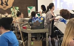 Students socialize, create artwork at Paint and Sip event