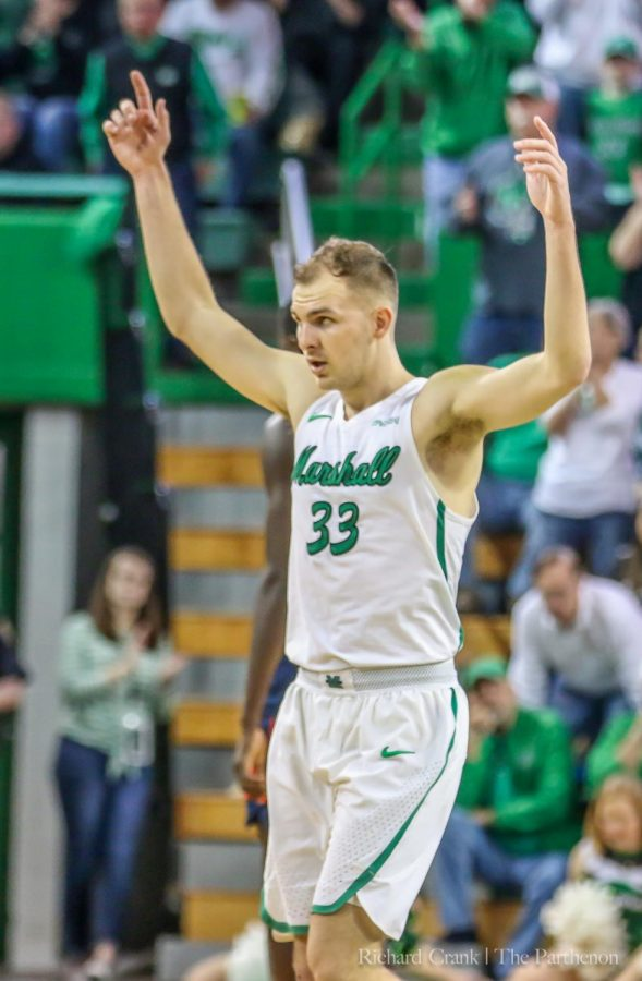 Marshall guard Jon Elmore (33) raises his arms in celebration during the Thundering Herd's 15-point win over Florida Atlantic at the Cam Henderson Center on Mar. 9, 2019.