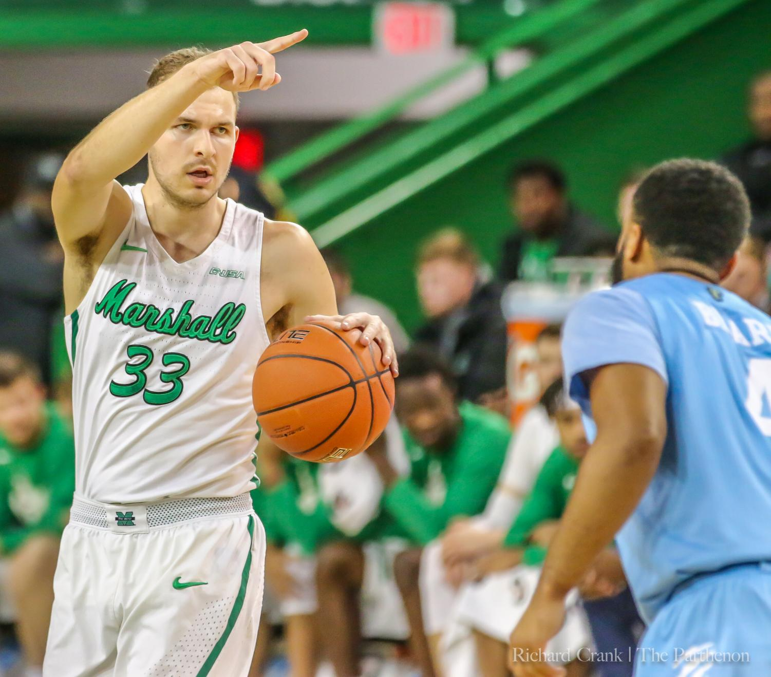 Marshall guard Jon Elmore (33) runs the offense during the Herd's win over FIU at the Cam Henderson Center on January 19, 2019. Elmore was named C-USA Player of the Week on Monday.