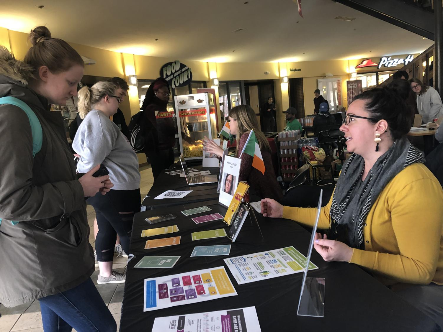Claire Snyder, program coordinator for Marshall's Women and Gender Center, provides information to interested students in the Student Center.