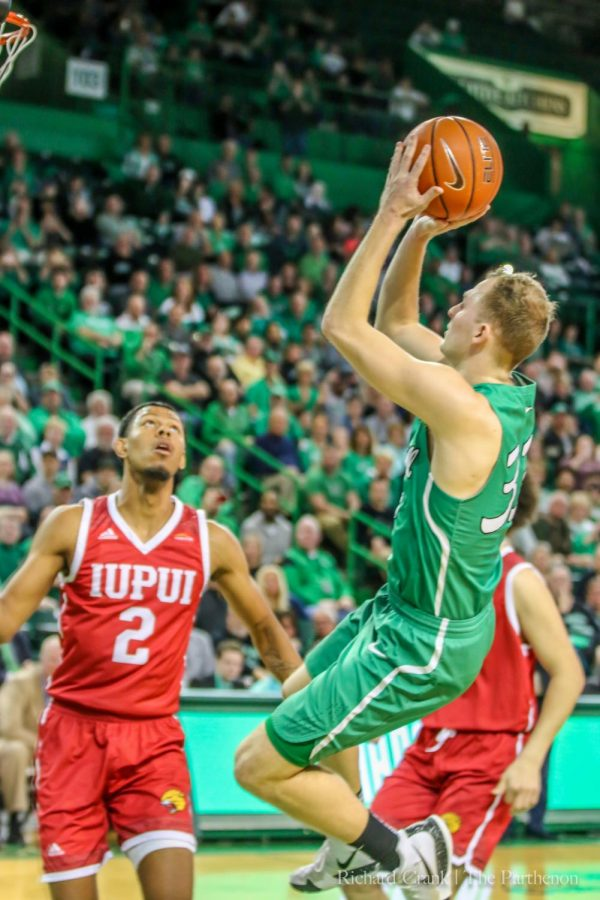 Marshall+guard+Jon+Elmore+%2833%29+attempts+a+jumper+during+the+second+half+of+the+Herd%27s+78-73+win+over+IUPUI+on+March+19%2C+2019.+This+shot+broke+the+school%27s+all-time+scoring+record.