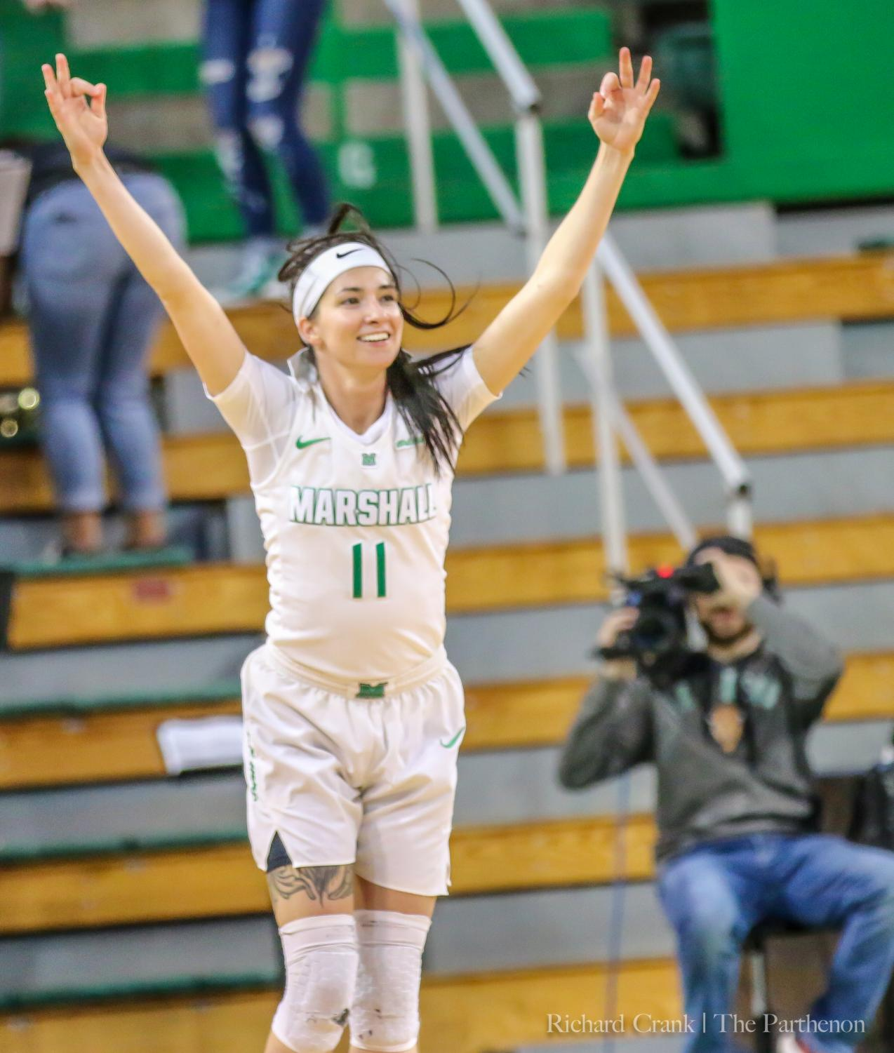 Marshall guard Taylor Porter (11) celebrates one of her 10 made 3-pointers during the Thundering Herd's win over FIU on Mar. 7, 2019 at the Cam Henderson Center.