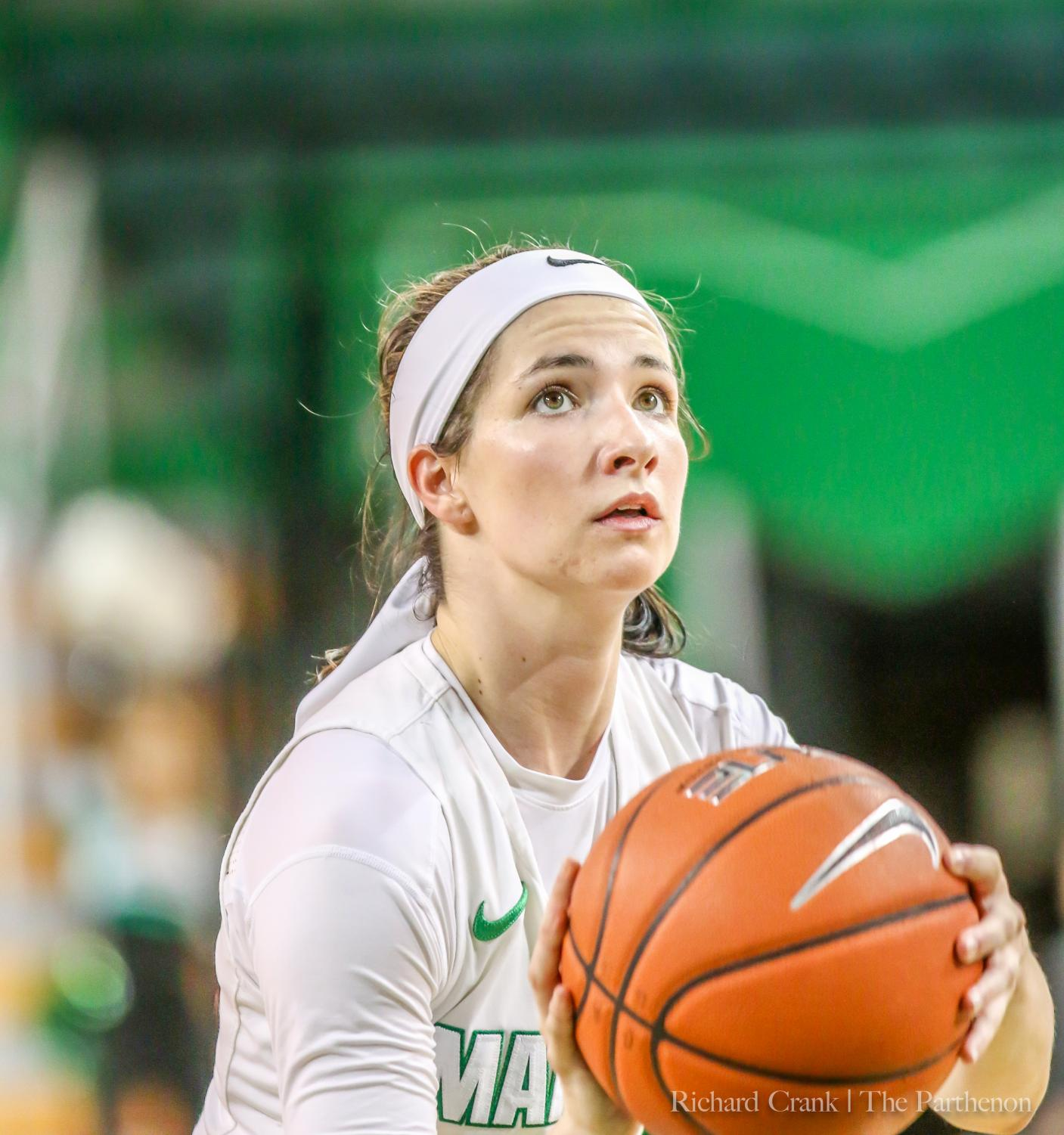 Marshall guard Taylor Porter (11) shoots a free throw during the Thundering Herd's game against North Texas at the Cam Henderson Center.