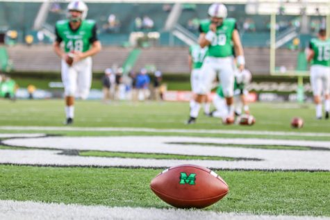 Green impresses in college debut, leads Marshall to season-opening win