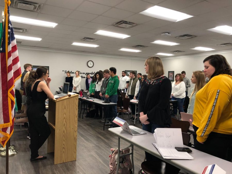 Student+Body+Vice+President+Hannah+Petracca+and+Student+Government+Association+senators+stand+before+an+opening+prayer+and+Pledge+of+Allegiance+during+the+SGA+meeting+in+the+Memorial+Student+Center+March+19.