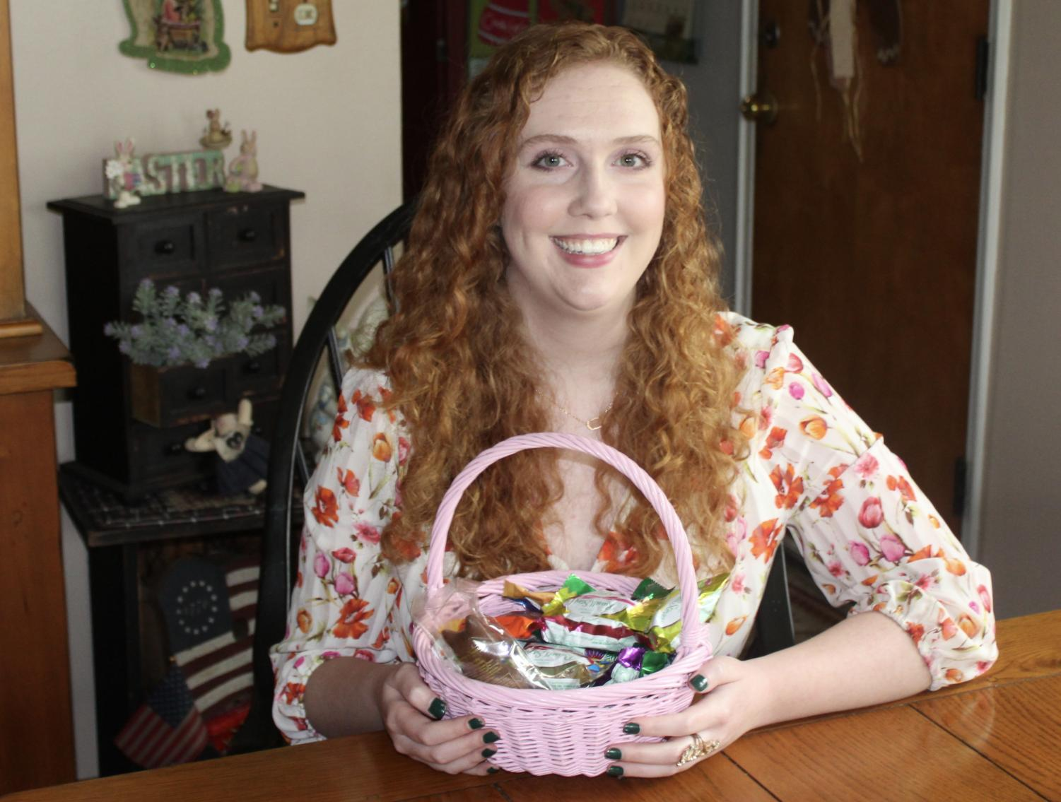 Amanda posing with her Easter basket, eager to dig in to the candy and chocolates, some of her absolute favorite things.