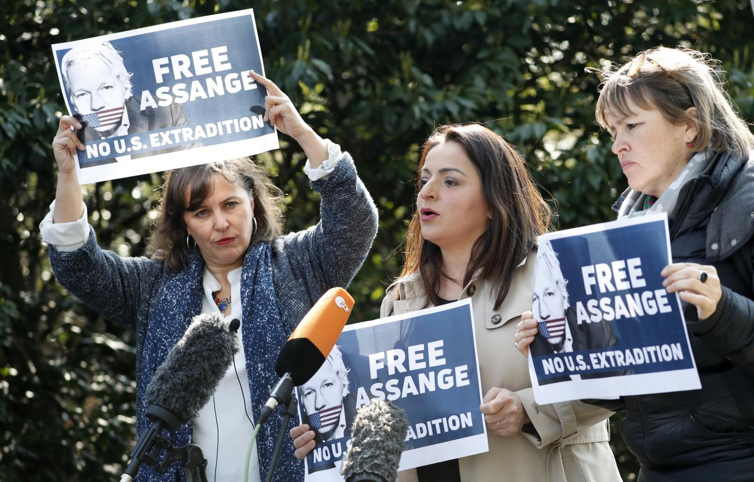 German members of the Left Group in the Bundestag Heike Hansel, right, and Sevim Dagdelen, center, together with Spanish MEP Ana Miranda hold a press conference outside Belmarsh Prison in support of WikiLeaks founder Julian Assange who is currently being held in Belmarsh, in London, Monday, April 15, 2019.