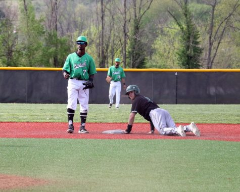 Marshall shortstop Elvis Peralta (7) watches as Ohio center fielder Michael Richardson slides into second base during the teams' midweek matchup at the Kennedy Center Field, April 16, 2019.
