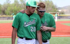Zach Inskeep (right) offers advice to Evan Hurn (left) between innings.