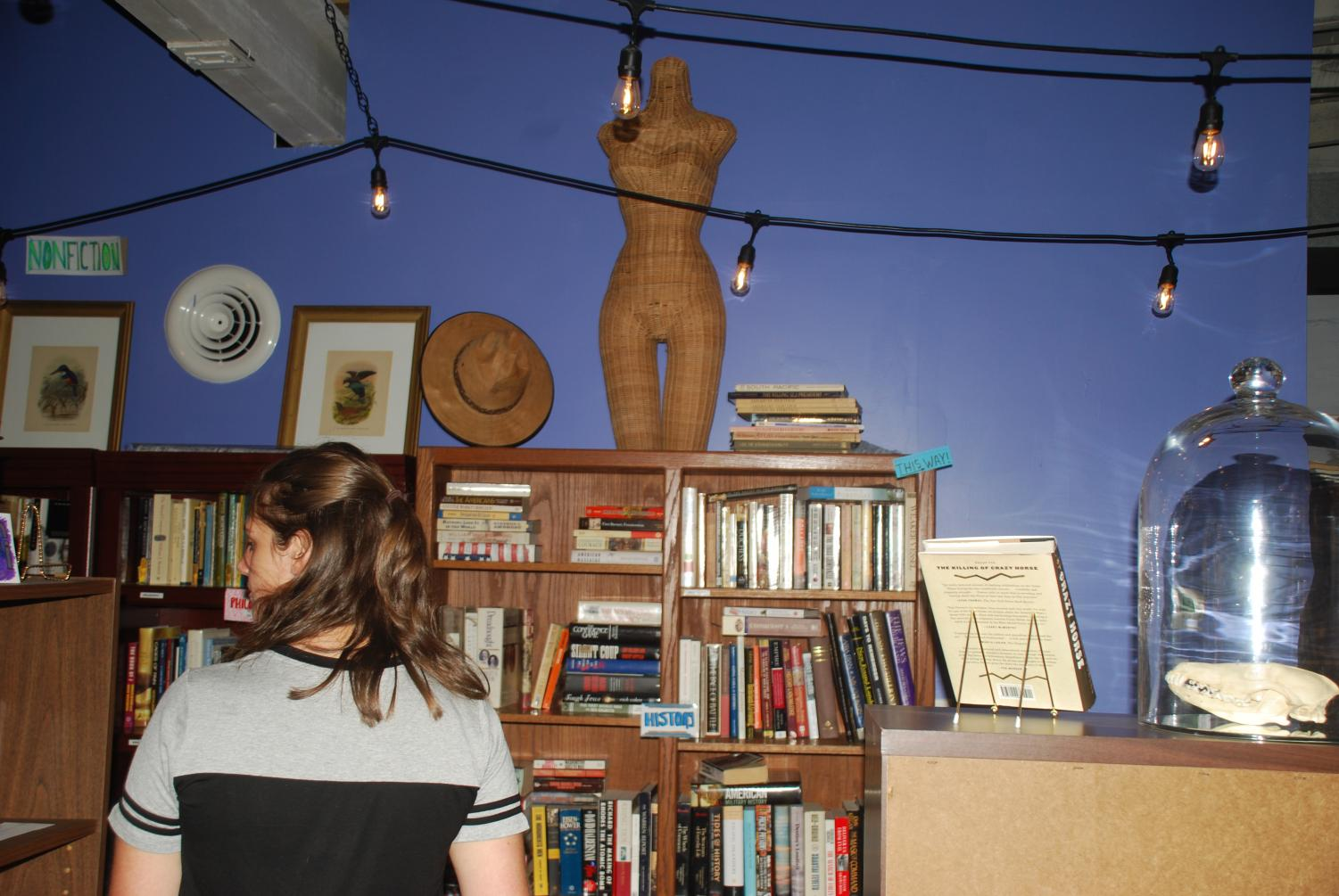 Amber Sturgill searched for her next potential read at Cicada Books and Coffee which opened in July 2018.