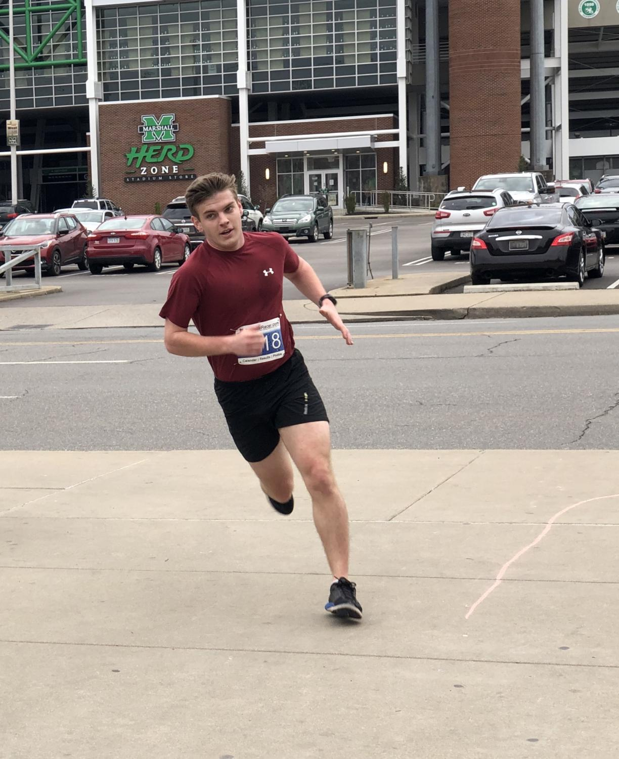 Jeremiah Parlock, a junior political science major and member of the Student Government Association, rounds the last bend of the We Will Run For You 5K route. Parlock was the second runner to finish the race.
