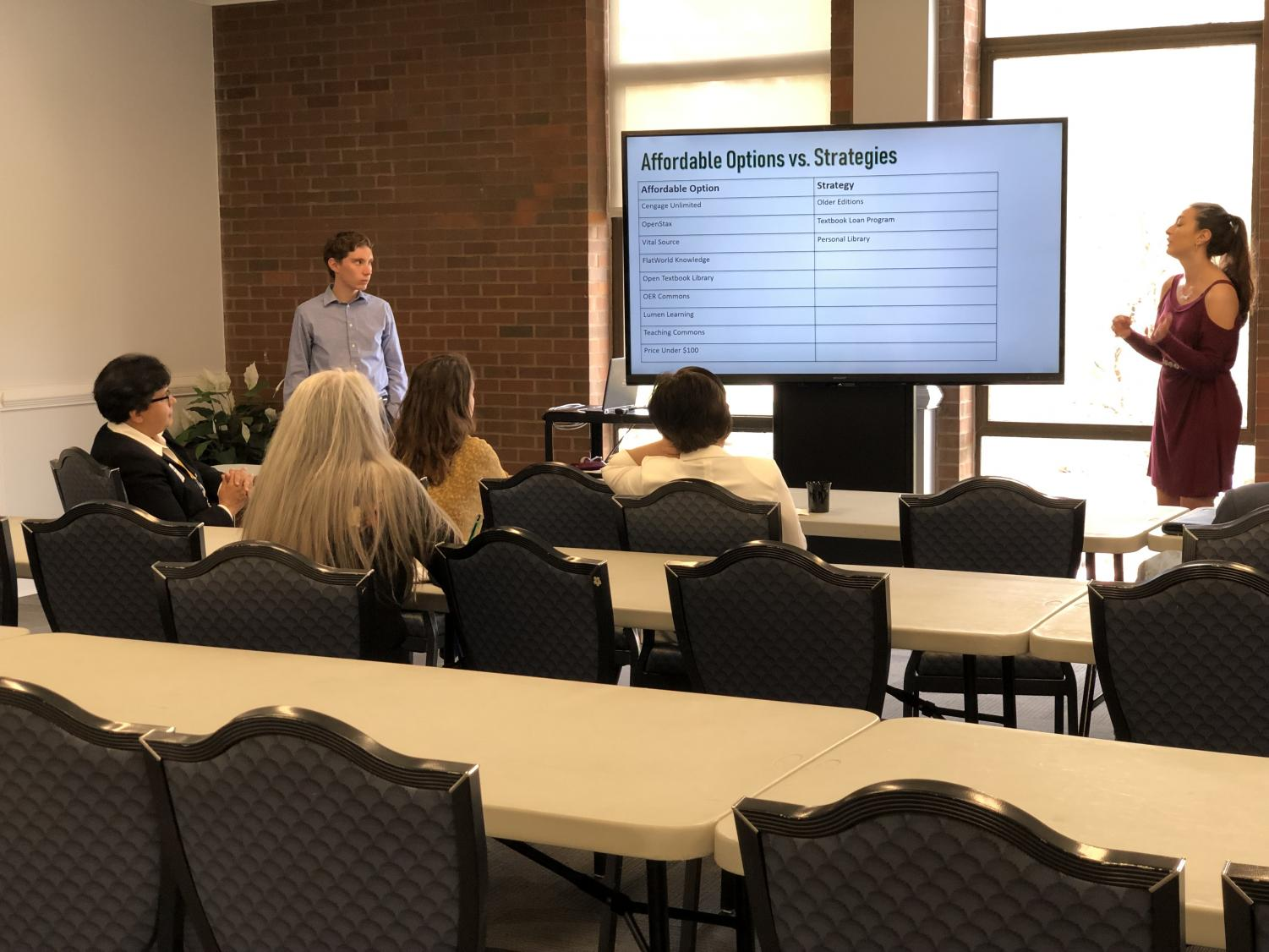 Student Body President Hunter Barclay and Student Body Vice President Hannah Petracca present information about affordable options and strategies during an Affordable Education 101 Material Training in the Shawkey Room of the Memorial Student Center Thursday.
