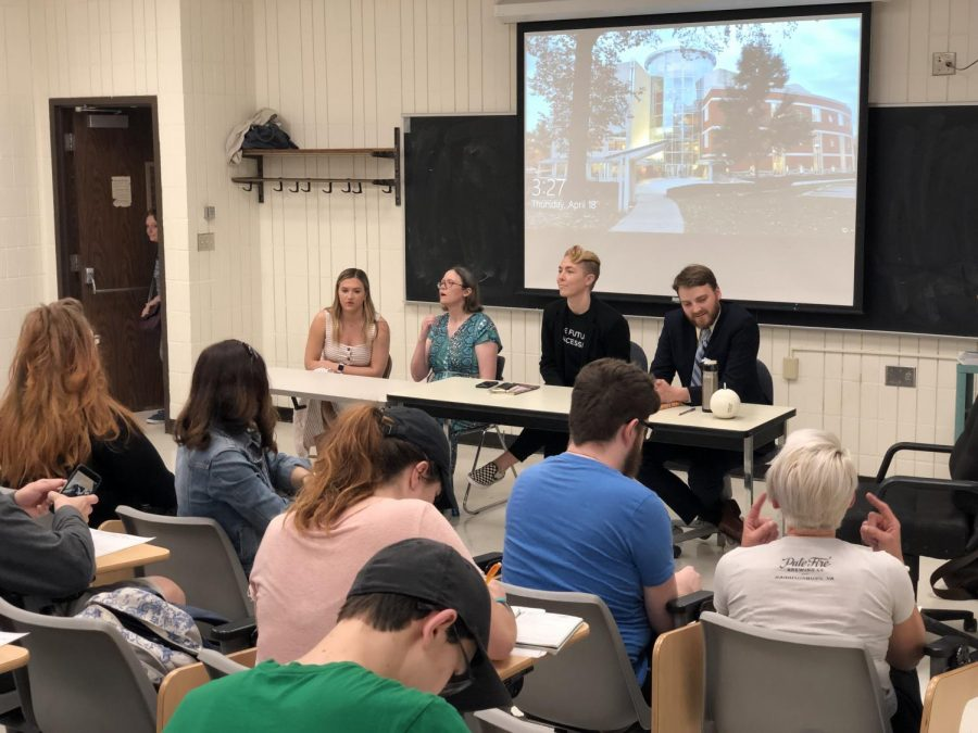 Panelists Marshall student Kate Colclough, Marshall assistant professor Carrie Childers, visiting poet Meg Day and visiting author David Wanczyk prepare to discuss disability and creativity during a panel discussion Thursday in Corbly Hall.