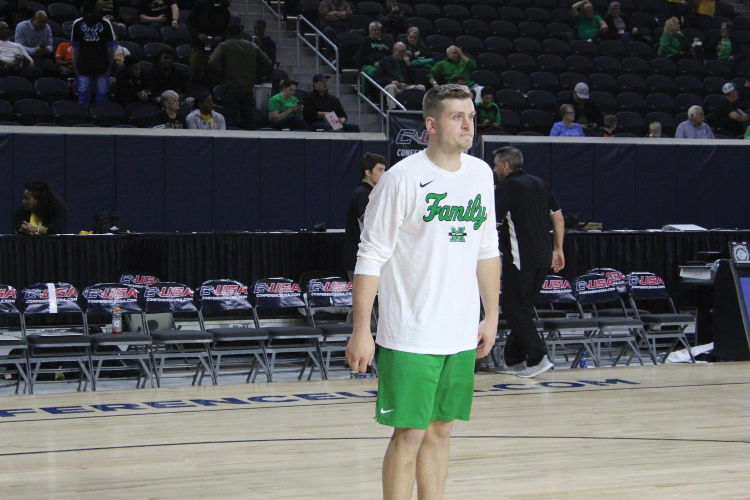 Marshall men's basketball co-head manager Danny Feck prepares to rebound a shot from one of the Herd's players during warmups prior to a Conference USA Tournament game against Southern Miss on March 14.