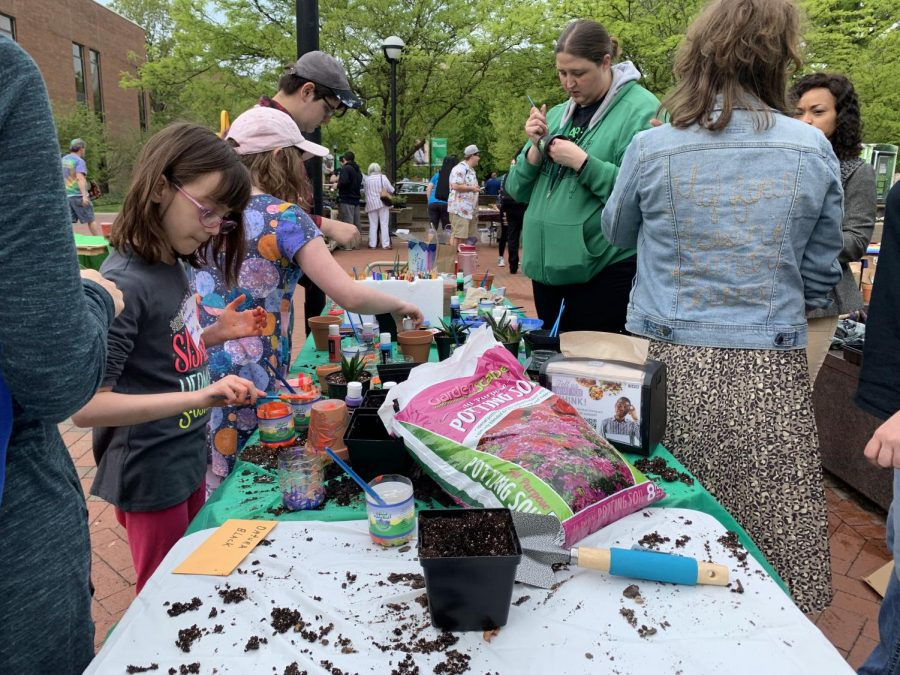 Students and community members celebrate Earth Day with plant sales, interactive activities for kids and booths with information on recycling and other environmental initiatives in the area at the Memorial Center Plaza April 24.