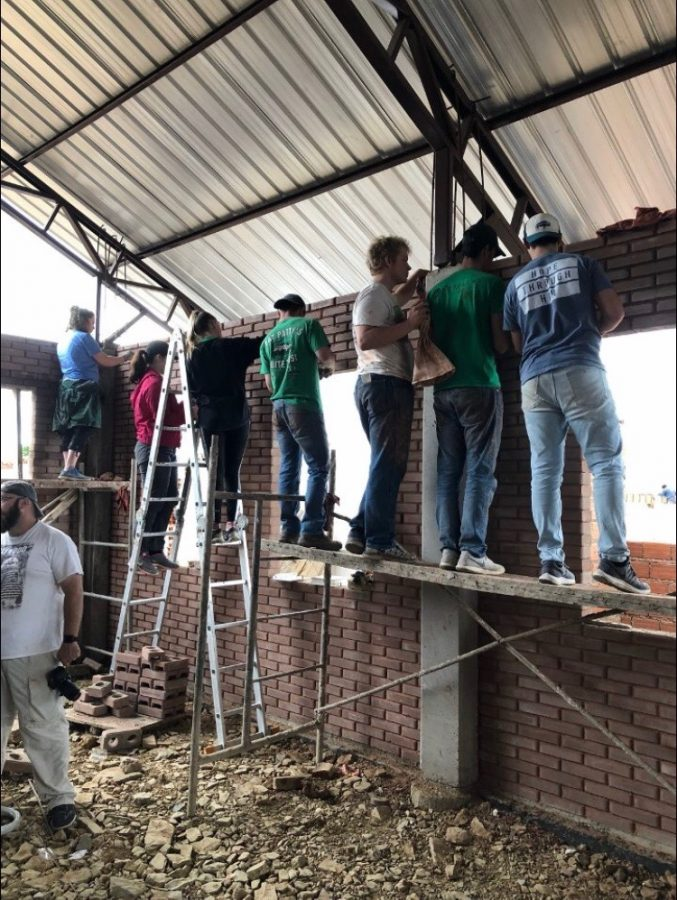 BCM+Members+help+grout+walls+for+a+church+being+built+in+Cochabamba%2C+Bolivia.