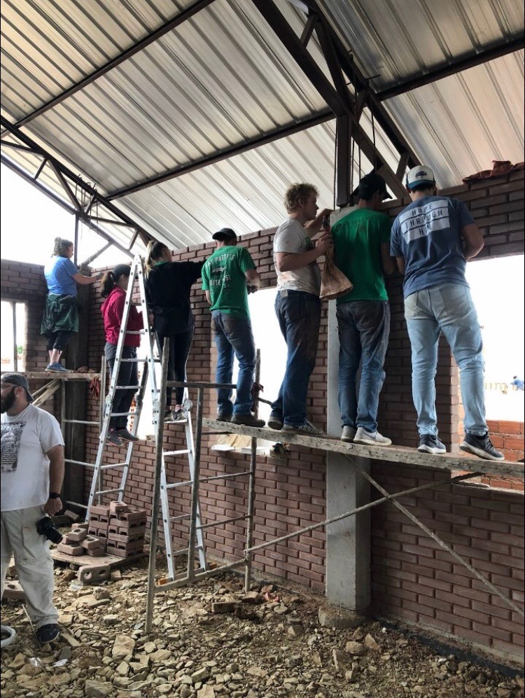BCM Members help grout walls for a church being built in Cochabamba, Bolivia.
